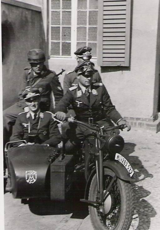 German officers and a paratrooper on a sidecar.