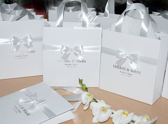 100 white wedding gift bags with satin ribbon and your Names #weddingwelcomebags #silverwedding #weddingwelcomebag #customdesign #giftbags #giftbag #gifting #personalizedweddings #personalizedgift #giftwrapping #customgift  #weddingfavors #welcomebags #paperbags #weddingwelcomebag #partybags #weddingfavor #welcomebag #paperbag #partybag #bridalshowerbags #guestwelcomebags #hotelwelcomebags #weddingfavours #elegantweddingbags #customeweddingbags #personalizedwelcomebags #destinationwedding