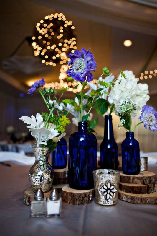 cobalt blue bottles silver mercury glass and wood rounds with blue and white scabiosa blue wedding centerpieceswooden