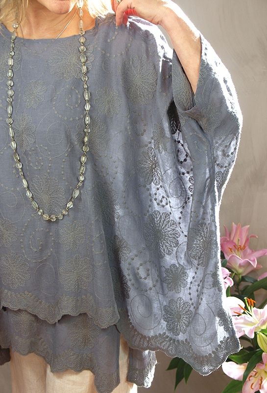 Santanyi Top in embroidered fine wool. £195 over, vest top layer £80, over Attius Trousers in natural linen, £215.