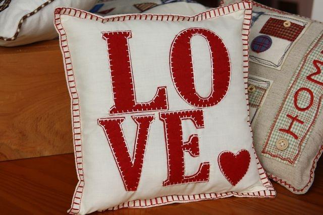 """LOVE"" square cushion with appliquéd L O V E in red – 24cm x 24cm"