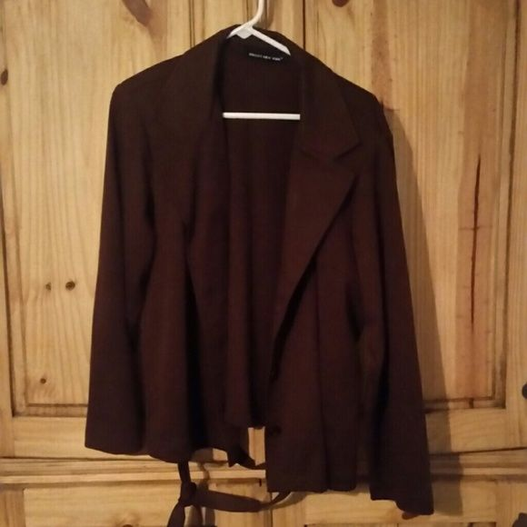 Ladies Briggs New York chocolate brown jacket Ladies Briggs New York chocolate brown jacket made out of a microsuede like material. Belts at the waist and hits just past the hips. Very good looking piece for any wardrobe!!! Comes from a smoke free home. Please contact me with any questions. Jackets & Coats