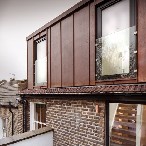 Rust-coloured copper home extension by Poulsom Middlehurst sits above the red-brick walls and clay-tiled roof of a Victorian terrace in east London