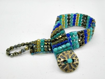 Bead Loom Weaving:  Make and awesome beaded cuff with this cool loom design!