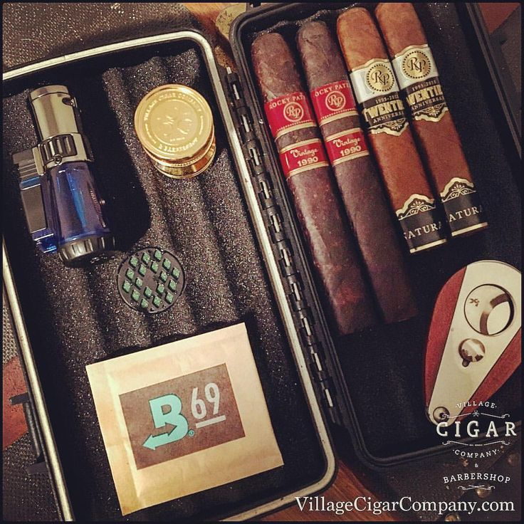"""Traveling soon? Take us with you!! Before you go, be sure to stop by one of our shops and pick up a travel humidor packed full of our """"Cigar Of The Month"""" features from Rocky Patel cigars! Village Cigar Company & Barbershop Burlington &..."""