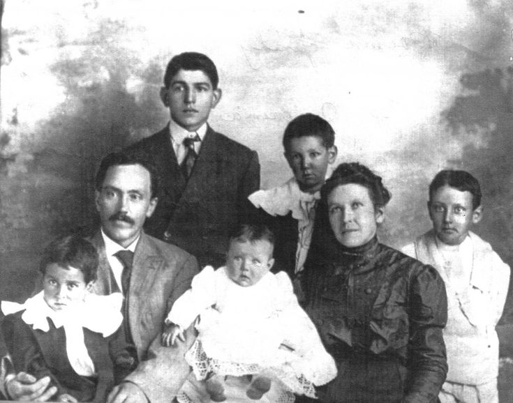 """Barney Baima Family – Shown here are Bernard and Adriena Baima with their five sons: Joe, Peter, John, Valentino, and Adolf, also known as """"Buff."""" Barney, as he was known, and Adriena emigrated from Turin, Italy to Renton in 1901, before moving to Newcastle in 1902. Four years later the Baima family moved into Pacific Coast Company House #75, which was to be associated with the Baimas for the next eight decades. However, 15 years of coal mining left Barney """"gasping, choking for air, a victim…"""