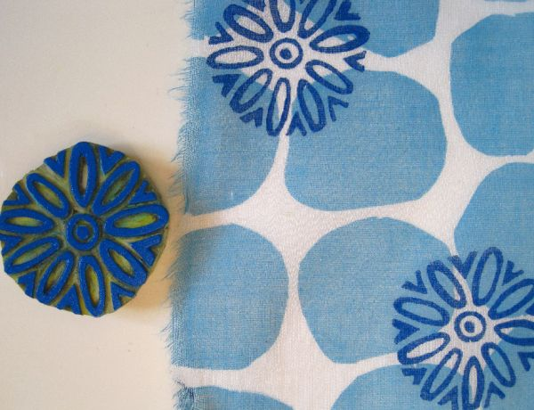 I like the idea of printing over pre-printed fabric. cool.