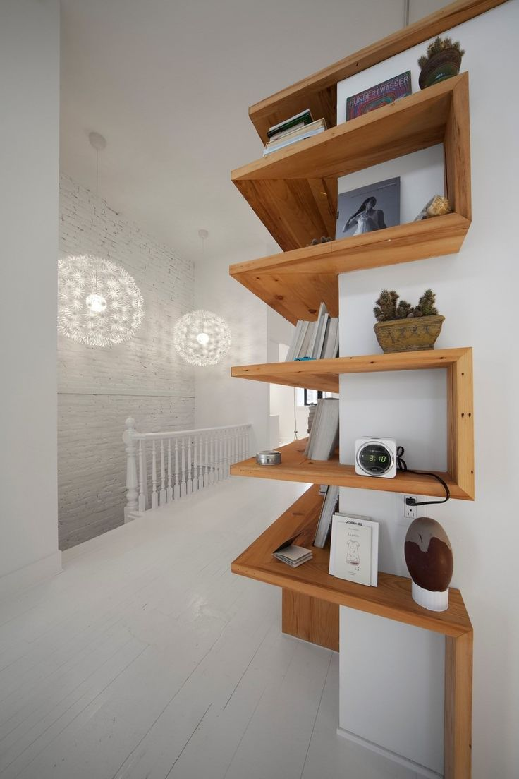 Interesting use of space-wrap around shelving...Juliette Aux Combles by L. McComber Ltée