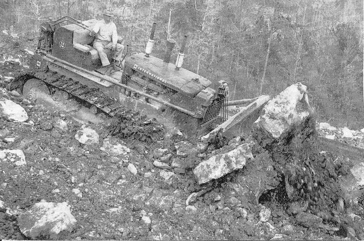 This Oregon, USA based TD-24 is engaged in building a forestry haul road. Judging by the size of some of the boulders it has its work cut out for it. It is equipped with a Bucyrus-Erie blade and Isaacson cable control.