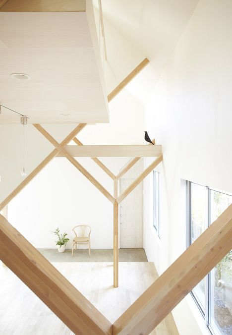 Y-shaped wooden columns support rooms and lofts at different levels inside this family house in Matsudo, Japan, by Hiroyuki Shinozaki Architects