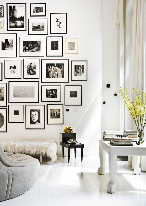 Wall of photos in black and white..