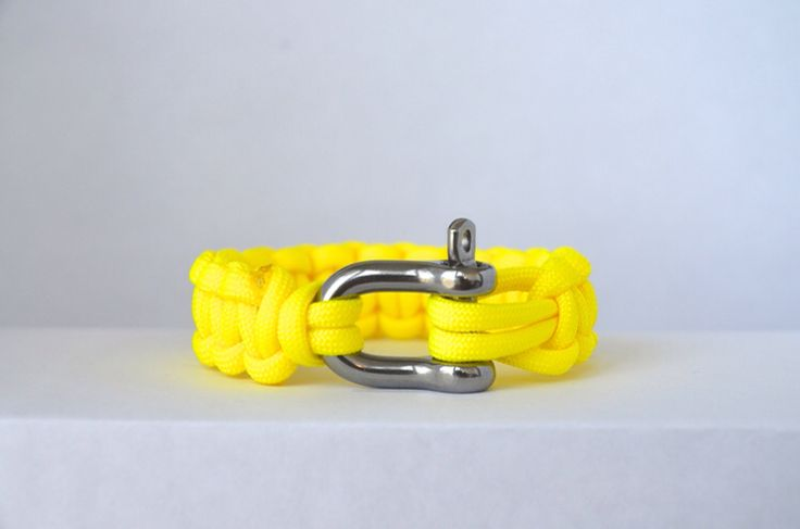 Neon Yellow // Paracord Survival Bracelet | Yellow is the colour for optimism and cheerfulness. When looking at this Neon Yellow band it will brighten your day. This high visibility yellow can be spotted a mile away and always stands out in a crowd. This is a Beacon favourite because is has served as a perfect statement piece for any wardrobe.  #Paracord #FunctioningWithStyle #BeaconLaunch2015 #Neon  #ComfortChic