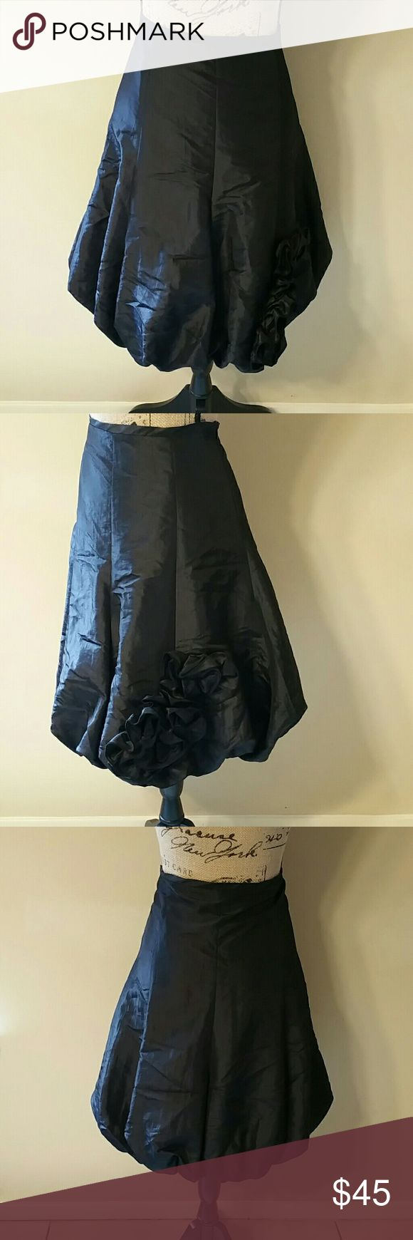 """{Joseph Ribkoff} Black Jupe Puff Skirt Cute black jupe puff skirt by Joseph Ribkoff. Has flowers designs in the front. Ruffle detail. Narrows at the end of the skirt. Size 6. In good used condition.  No tears or stains. Measurements - Waist: 15"""", Hips: 23.5"""", Length: 23"""" Joseph Ribkoff Skirts Circle & Skater"""
