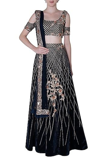 669a724f7b8c83 PINK PEACOCK COUTURE Featuring a navy blue lehenga skirt in velvet base  with 3D rose gold handwork embroidery. It is paired with a matching cold  shoulder ...