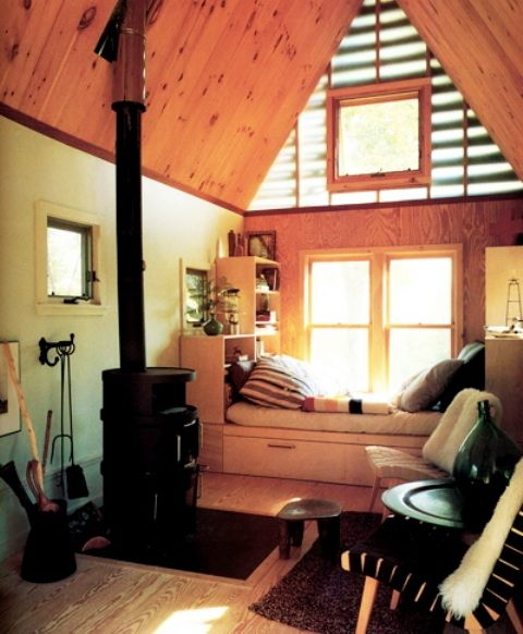 36 Rustic Barns Bedroom Design Ideas.  LOVE the small wood burning stove & the nook by the window.