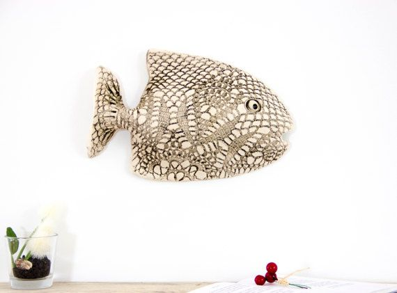 Ceramic 3D wall decoration sculpture art clay FISH - home decor wall art. A wonderfully hand formed and sculpted ceramic white wall decoration. The product is made of natural clay. Natural clay color, decoration is not under glaze, glaze binder only part - that highlights the features of the product. This wall decor has lace imprint texture. This handmade sculpture of a fish is designed to mount on the wall on a screw or nail. This wall decoration can be displayed indoors, also can be…