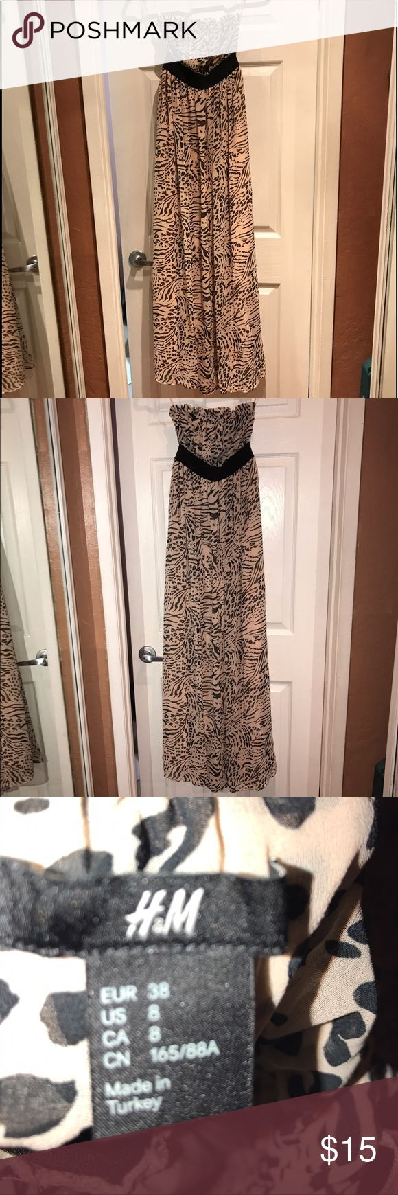 Size 8 long dress Creme color with black size 8 H&M animal print, long dress.  I am 5'7 and it's down to my ankle H&M Dresses Maxi