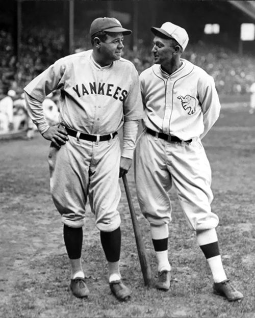 Babe Ruth and Ty Cobb. Ty Cobb stole home 54 times during his career.