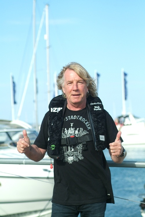 Rick Parfitt from rock band Status Quo wearing a custom black velvet life jacket made in cowes, UK. www.seasafe.co.uk