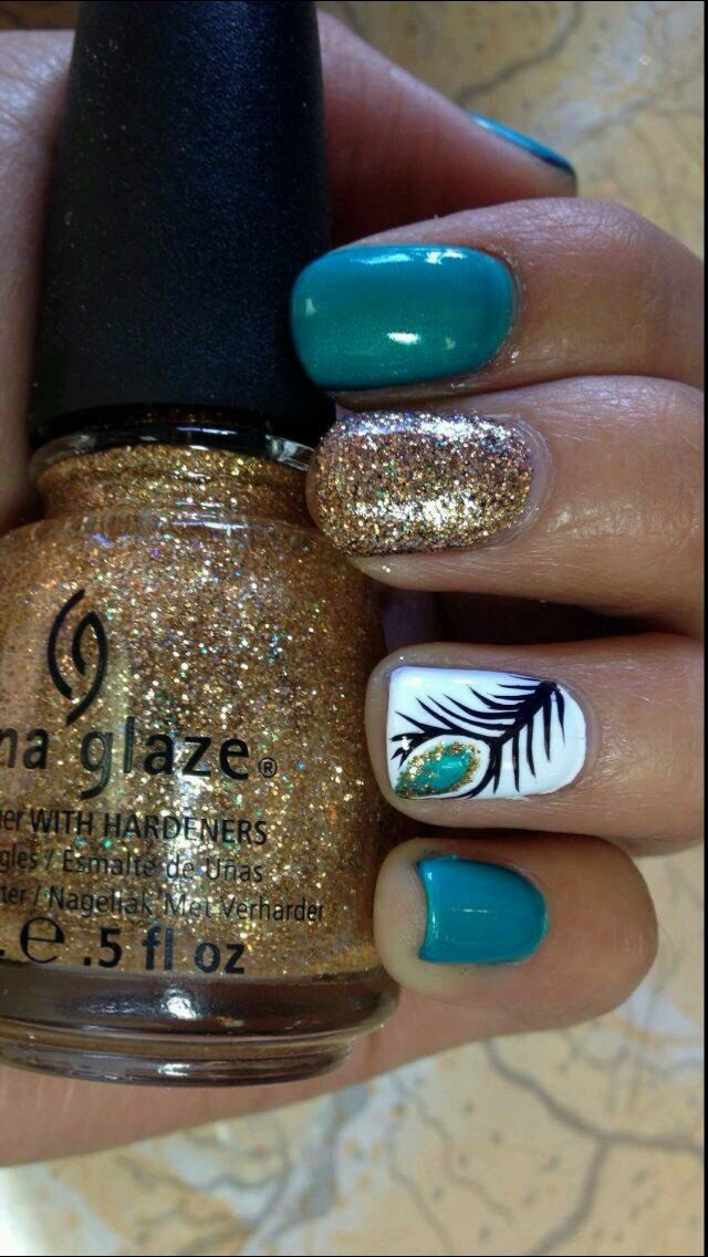 Blue Sparkly Feather Nails