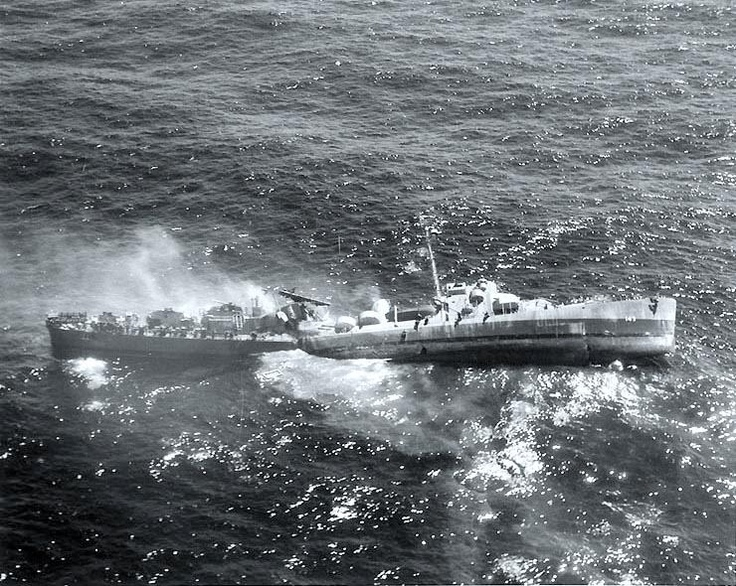 USS Fiske (DE-143). Broken in two and sinking in the Atlantic Ocean on 2 August 1944, after she was torpedoed by the German submarine U-804. Note men abandoning ship by walking down the side of her capsizing bow section. Official U.S. Navy Photograph, now in the collections of the National Archives, 80-G-270257.