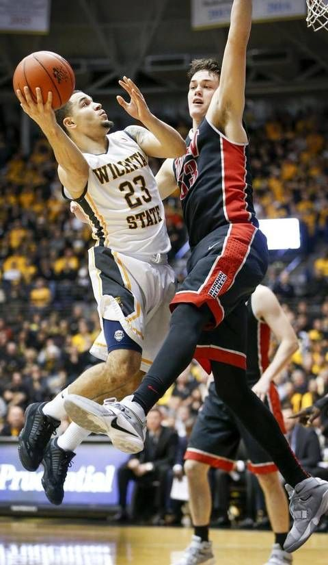 Wichita State's Fred VanVleet drives to the basket against UNLV 7-footer Stephen Zimmerman in the second half at Koch Arena Wednesday. (Dec. 9, 2015)
