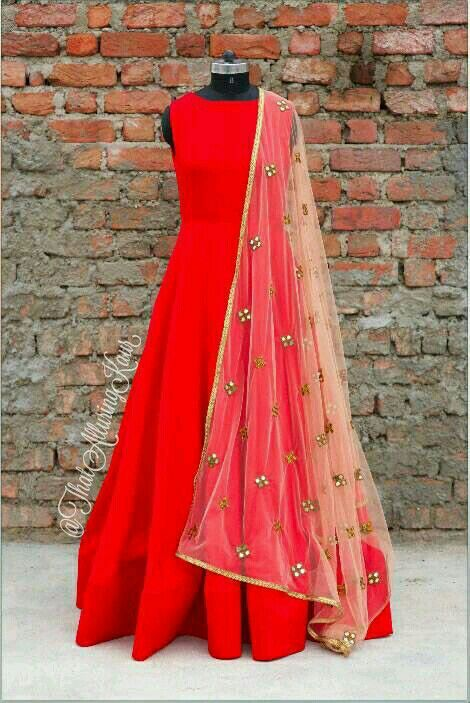 Plain red anarkali paired with at simple dupatta                                                                                                                                                                                 More