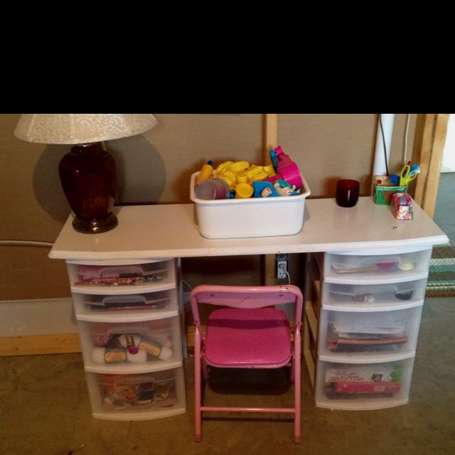 I actually like this idea! Its affordable and for storage, and while I'm working, they can be creative! Kids desk in the craft room