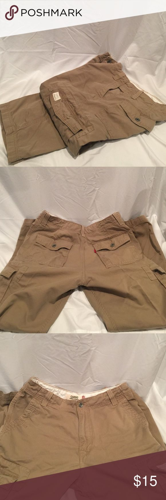 """Levi's Men's Khaki Pants Levi's Men's Khaki Pants with cargo pockets. """"Loose Straight"""". Great for athletic fit. Gives more room through the thighs. In excellent condition. Button fly and zipper closure, Back and side pockets button close. 34/32 Levi's Pants Cargo"""