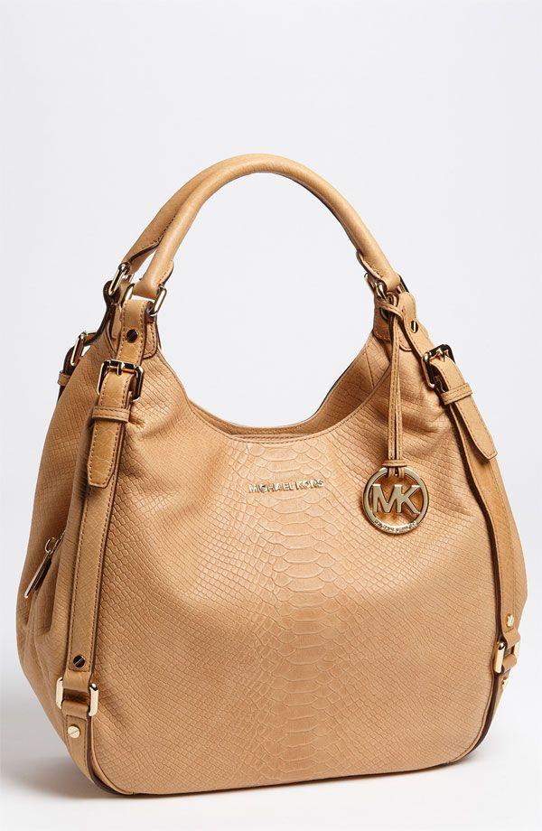 I am loving Michael Kors stuff.... This bag is bee-YOO-tee-full!!!
