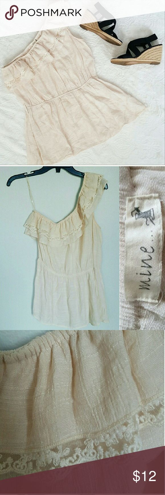 """MINE Cream Smocked Waist One Shoulder Smock MINE Cream Smocked Waist One Shoulder smock EUC no flaws besides original tie missing ( shown in photos). No need to wear a tie, or you can style with your own belt/tie to match any outfit! This cute top is a light, flowy material  ( material info in photos) and goes wonderfully with any pair of printed pants or jeans! Neck to hem 20"""", armpit to armpit 17"""", with at waist 13"""" (elastic in waist so it stretches), width at hem 22"""". MINE Tops Blouses"""