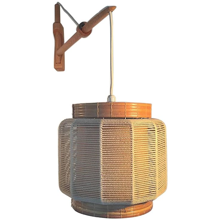 Wall Lamp in Oak, Twine and Wicker Designed by Kaare Klint | See more antique and modern Wall Lights and Sconces at https://www.1stdibs.com/furniture/lighting/sconces-wall-lights