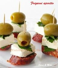 {THercs: I've had success with Hard Salami rounds, Brie, and a sliced wedge of our sweet & spicy Pickles. There are a ton of variations - experiment and enjoy :: Dried sausage cut 1 cm thick. Cheese cut into cubes. Put a piece of meat, a cube of cheese and an olive green above with each other and with a toothpick. Simple appetizer ready in 2-3 minutes.}