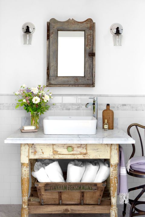 Give old pieces new life (and save on pricey cabinetry) by retrofitting old dressers, sideboards, and such to suit your needs. When topped with marble, an old desk (above) makes for a beautiful, patina-rich bathroom vanity. (Tip: A vanity should measure 34 to 36 inches tall.)