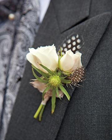 Quail feathers, scabiosa buds and tuberose