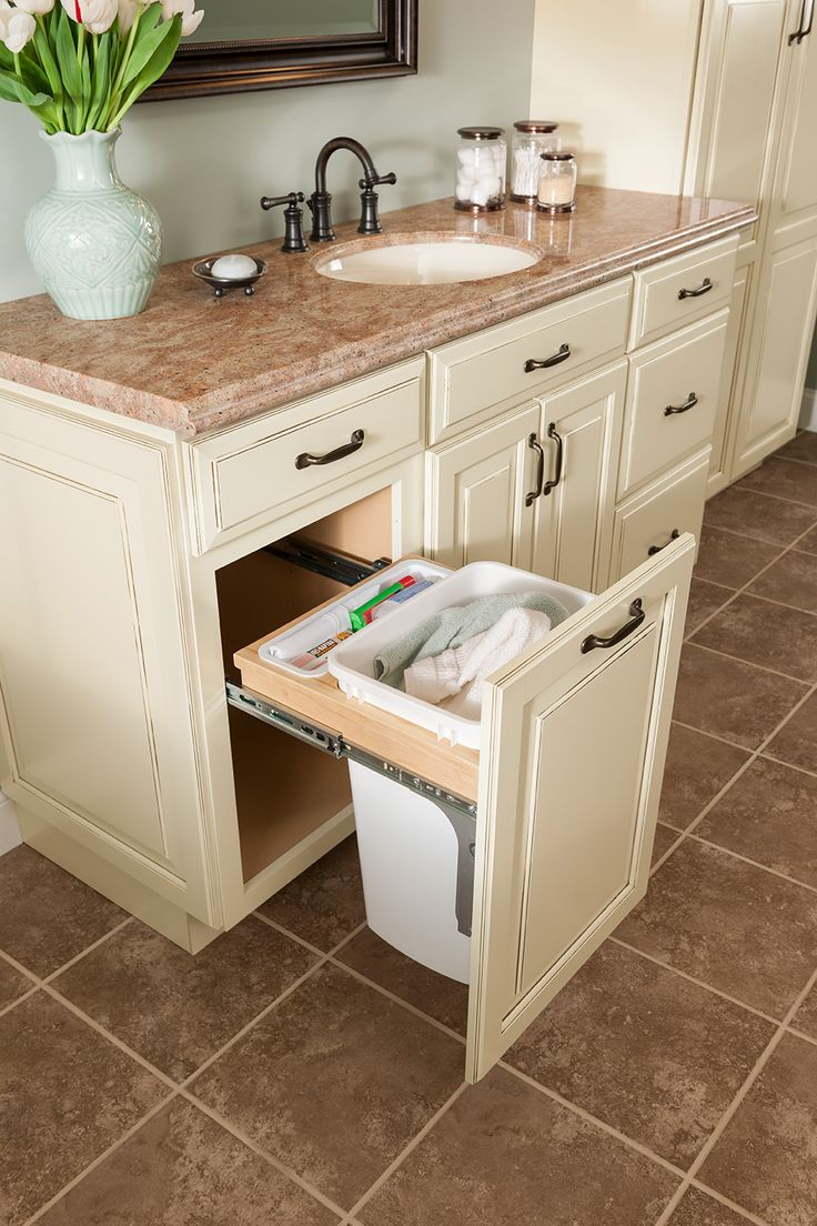 Shenandoah Cabinetry Painted Hazelnut, Winchester door.  Vanity with hamper pull out