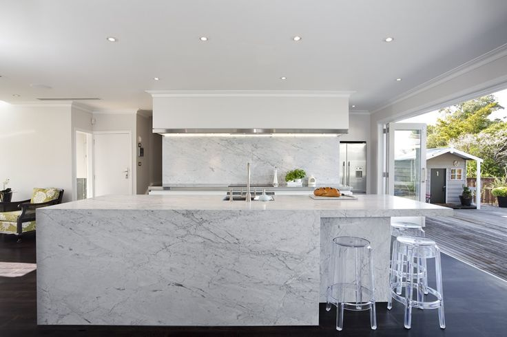 carrara marble flows over the top and down three sides of the