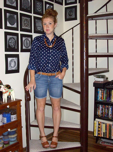 vintage navy and white polka dot blouse, jean shorts, brown accessories