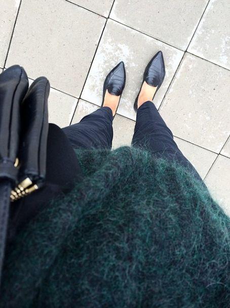 Loafers + dark green sweater.