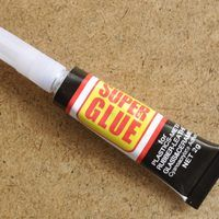 Super Glue is a product that lives up to its name—it's tenacious and seemingly impossible to remove once it has bonded with plastic. If Super Glue accidentally winds up on your plastic lenses, follow this surefire technique for removing the stubborn adhesive.