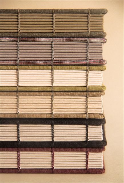 so lovely! It makes a bookbinder's heart sing to see all of these stitches lined up! Stack of books by Zoopress Studio