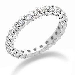 """The Eternity Ring ~ An alternative to the tradional full-band adornment is to only have the gems or diamonds  across the face of the ring. Don't be fooled by the name, though; this ring still has the same intention as a """"full-eternity"""" ring, which is meant to promise love for a full eternity-- no skimping here! This style might be better for those women who do a lot of tasks with their hands, as a """"full-eternity"""" ring could be a bit of a nuisance in this aspect."""