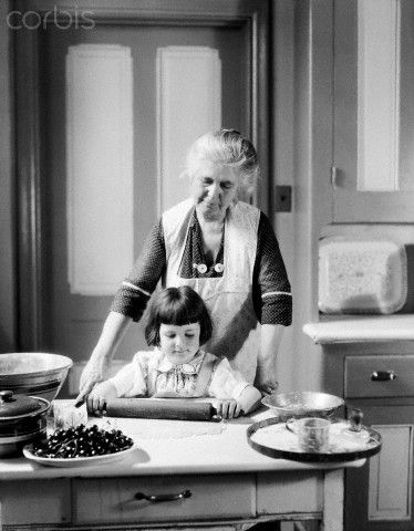 Baking a cherry pie with Grandmother, January 15, 1930. © H. Armstrong Roberts/CORBIS