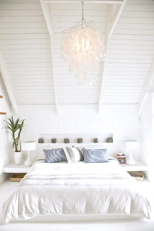White with accents of blues and greens. The perfect Summer bedroom inspiration.