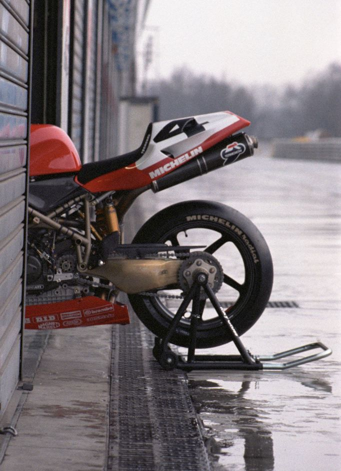 eternal beauty …  Carl Fogarty's Ducati 916SPS in the pits at Monza during a pre-season test in 1997