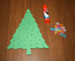 Punch holes in tree and have kids glue tissue paper on the