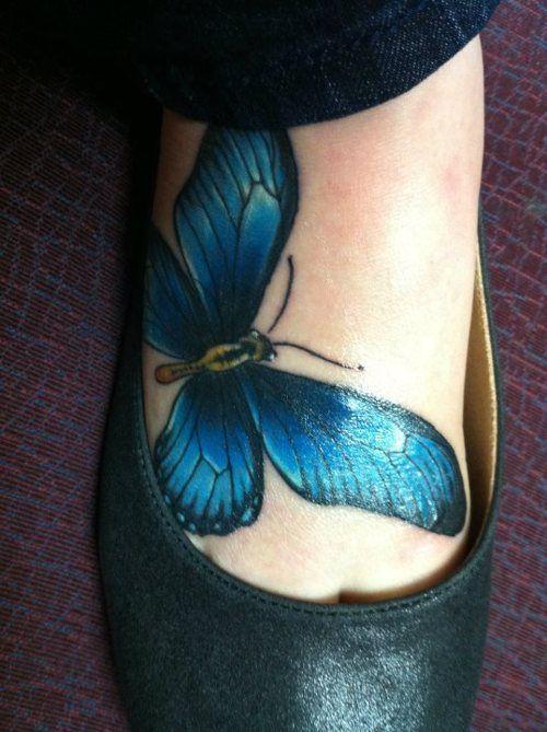 Blue butterfly foot tattoo