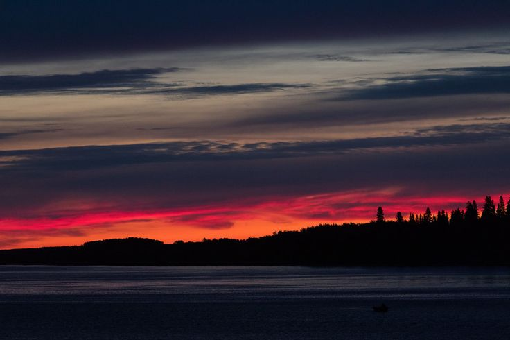 Looking towards north end of Butler Island before sunrise. Dark object in lower right is boat being rowed.