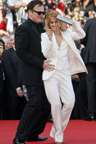 """Director Quentin Tarantino dances with actress Melanie Laurent as they arrive on the red carpet for the screening of the film """"Inglourious Basterds"""" at the 62nd Cannes Film Festival."""