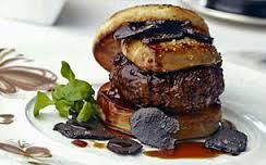OK, this is the real $5,000 burger. Only, it's free. You get the burger which is made of kobe beef, genuine foie gras, brioche bun and so on, plus a $5,500 bottle of Petrus wine. The chef brought the price down on the wine, so says he, the burger is free.  Available at Fleur in Las Vegas. No cheating and ordering the burger only.